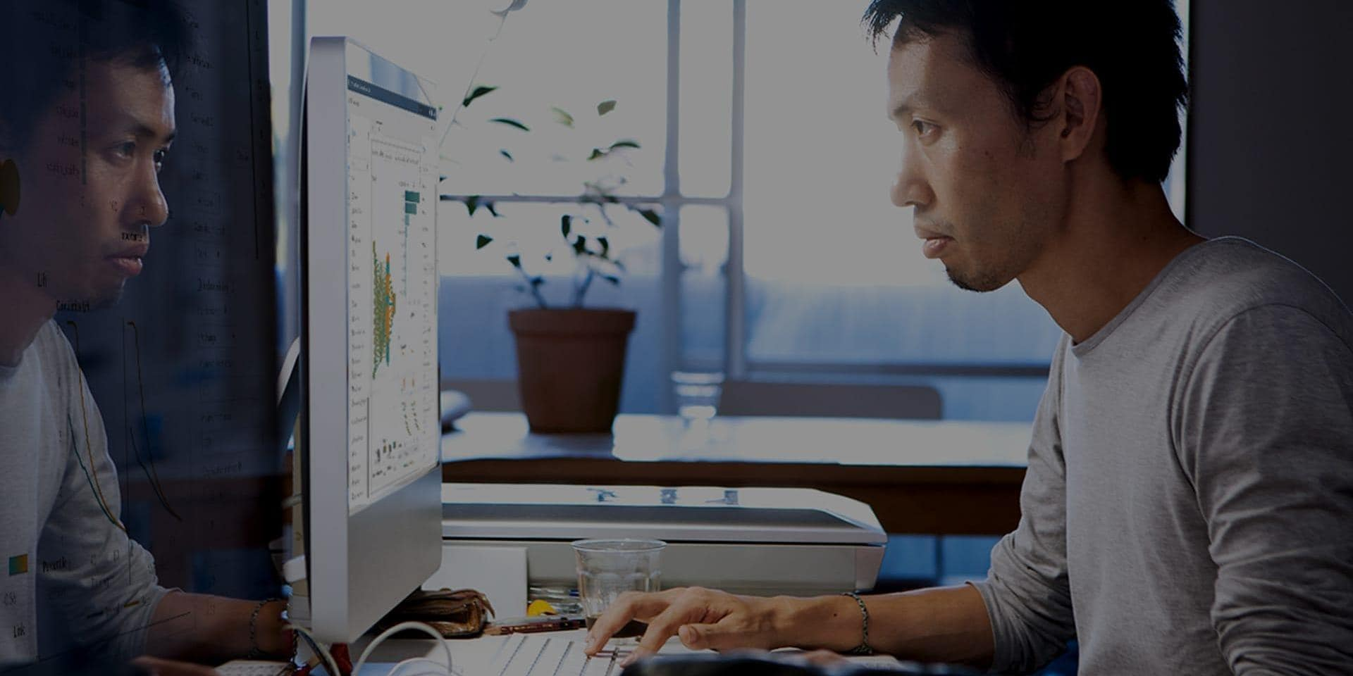 Young asian data scientist uses SAS® Visual Data Mining and Machine Learning to analyze data