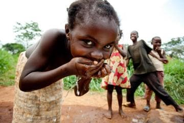 Child Smiling while Drinking Water