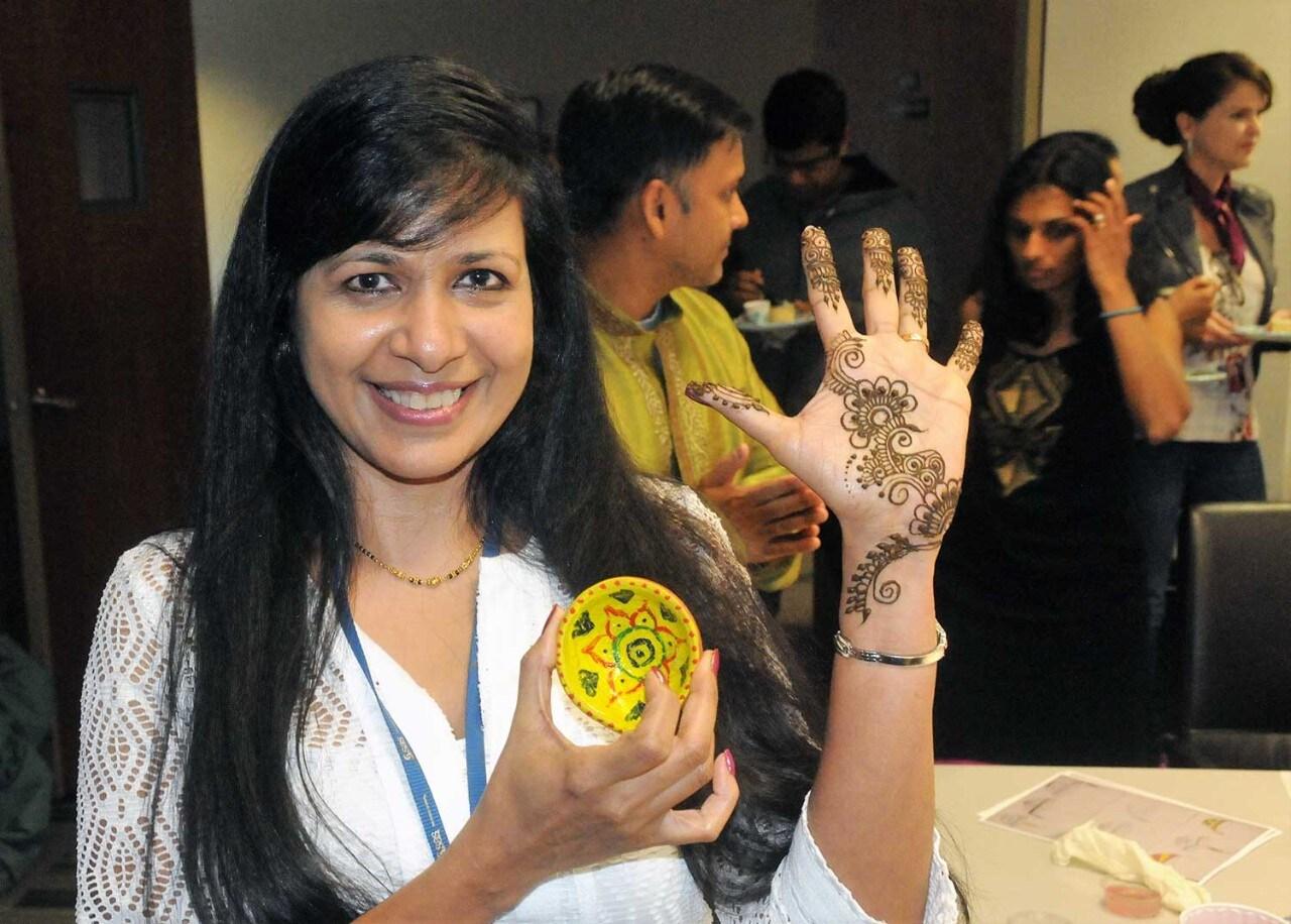 SAS employees painting at holi festival