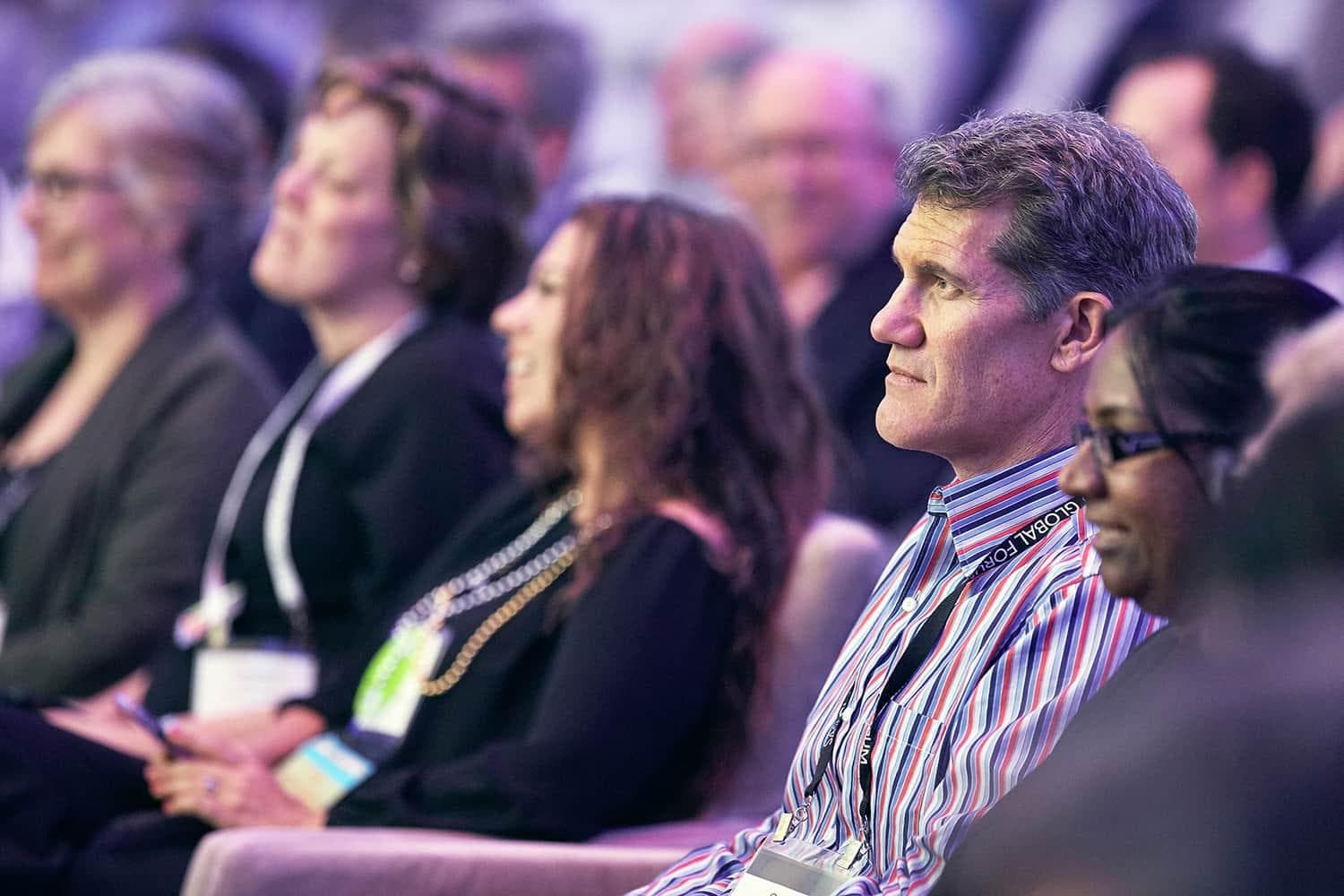 Man watching the stage in the audience at SAS Global Forum