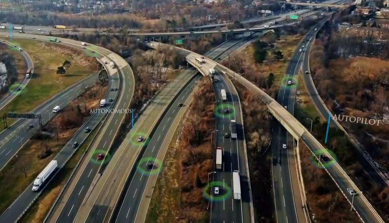 Aerial view of self driving cars on interstate