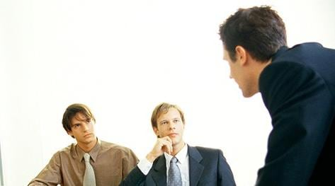 Three businessmen at conference table