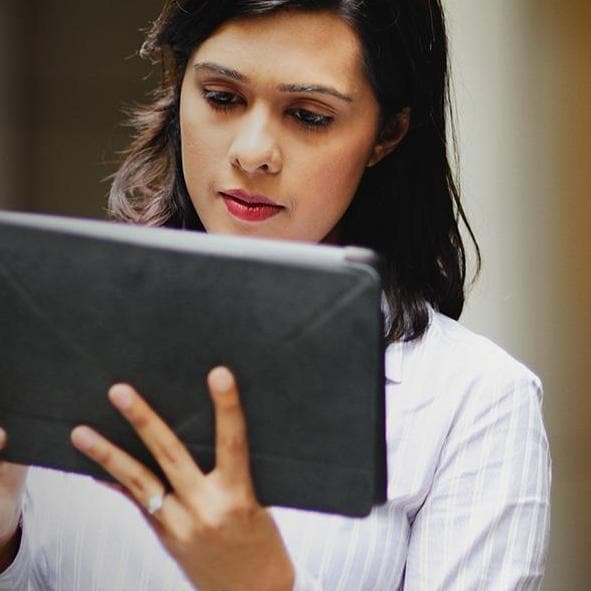 woman-with-tablet-outside-building.jpg