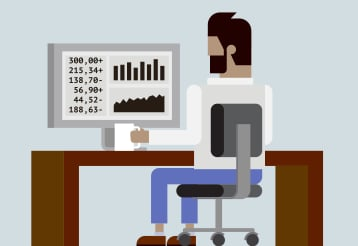Man at Office desk with Monitor Graphs