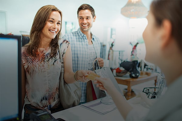 Man and woman shopping at retail store email background
