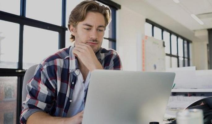 young professional data scientist studying on laptop