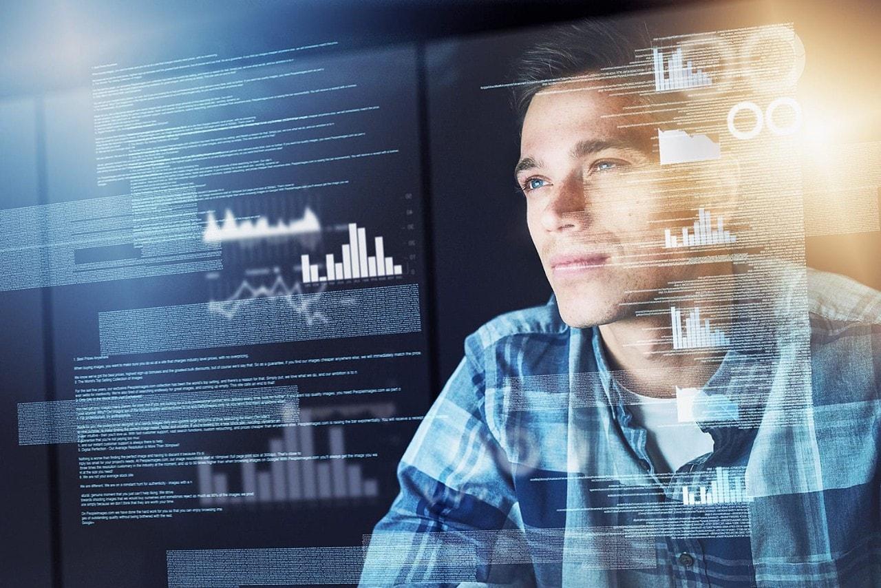 Male programmer coding on virtual monitor