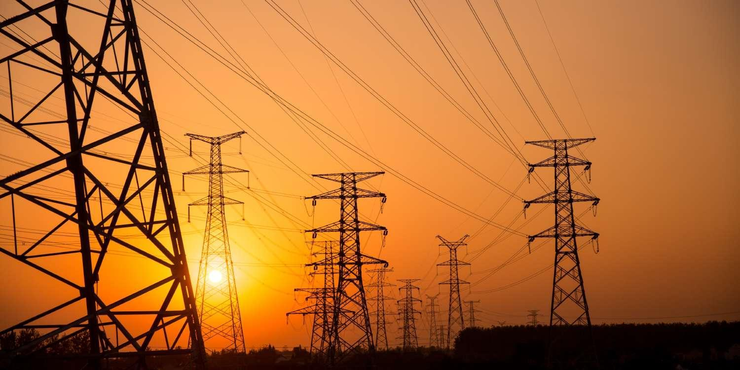 Electricity pylons at sunset