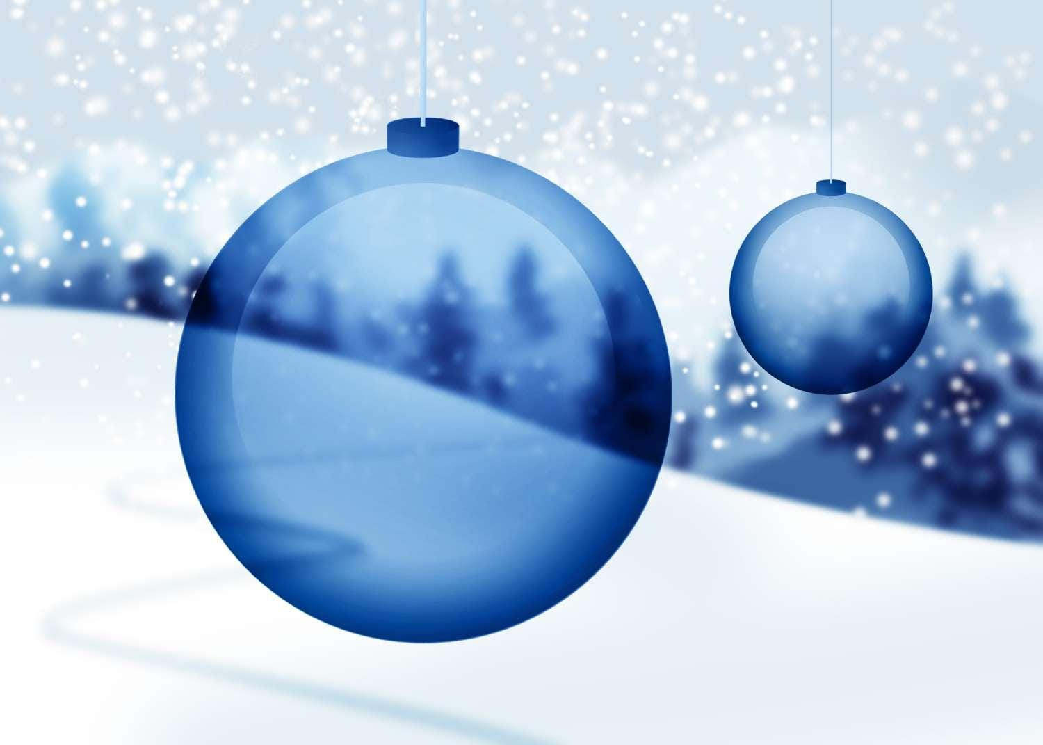 Transparent blue Christmas ornaments with snow