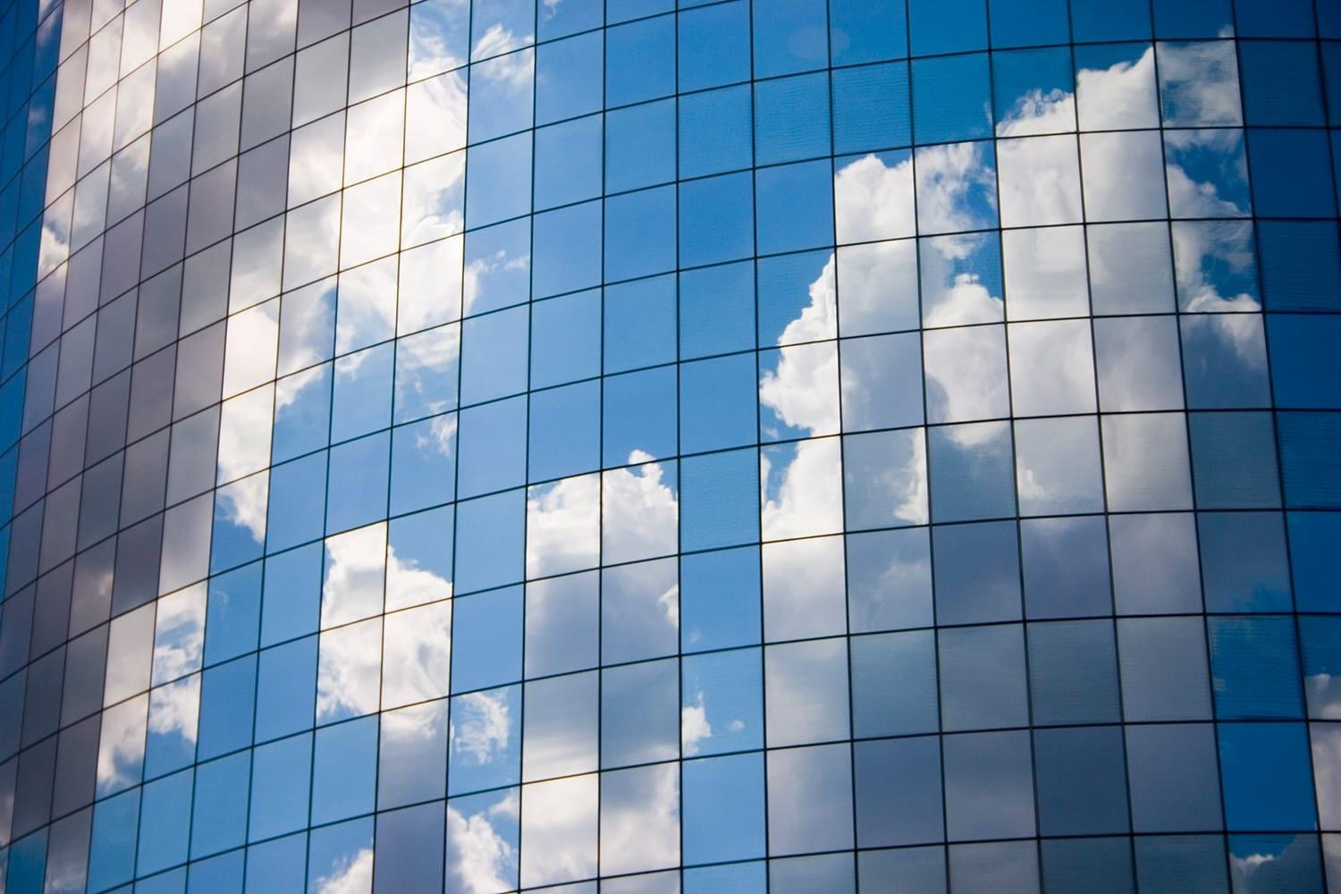 Clouds reflected on glass windows
