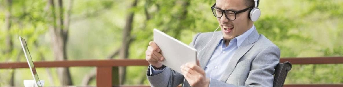 businessman watching video outside on mobile device