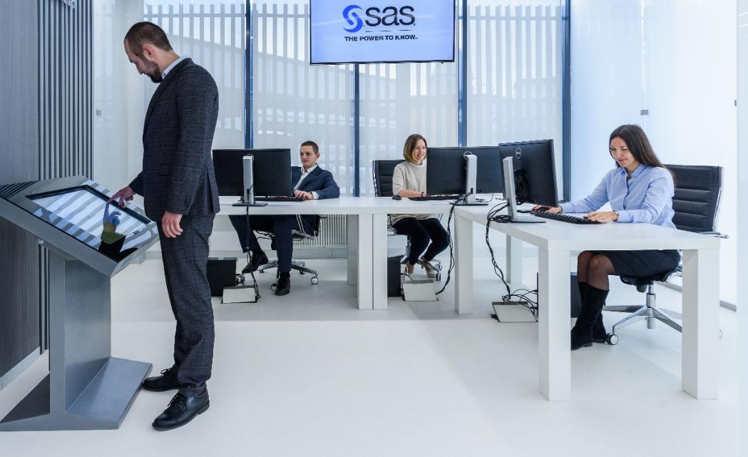 Man use interactive board in SAS Innovation Center Russia