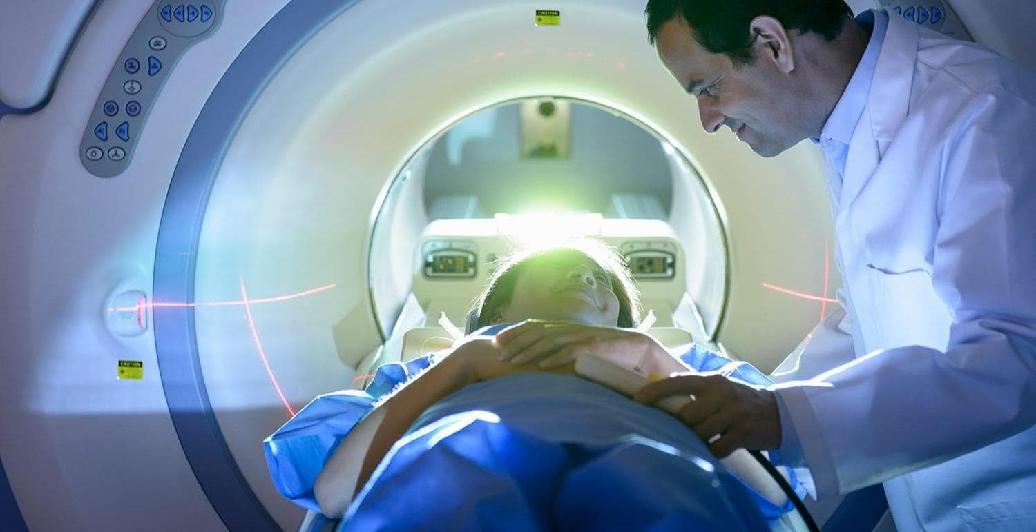 Doctor and patient using Magnetic Resonance Imaging