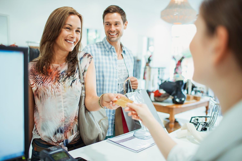 Man and woman shopping at retail store