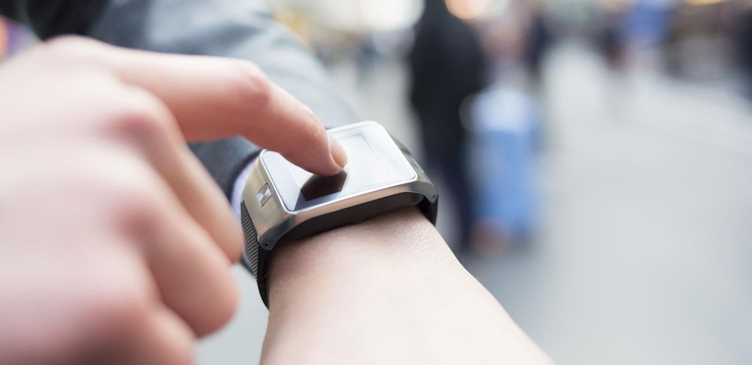 Person touching watch