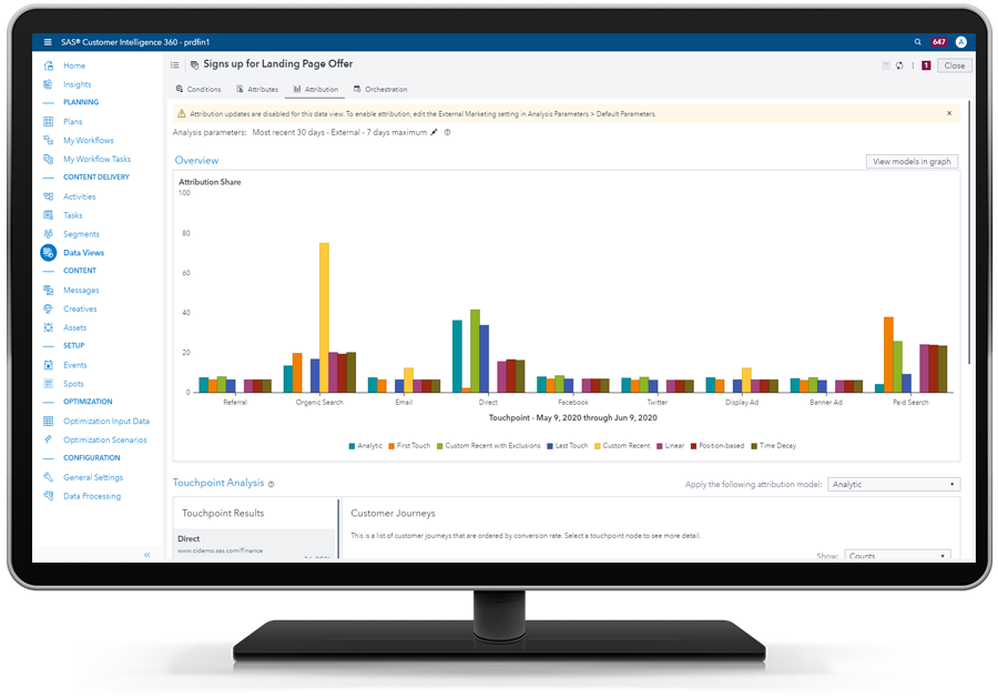 SAS 360 Engage showing loan application attributions on desktop monitor