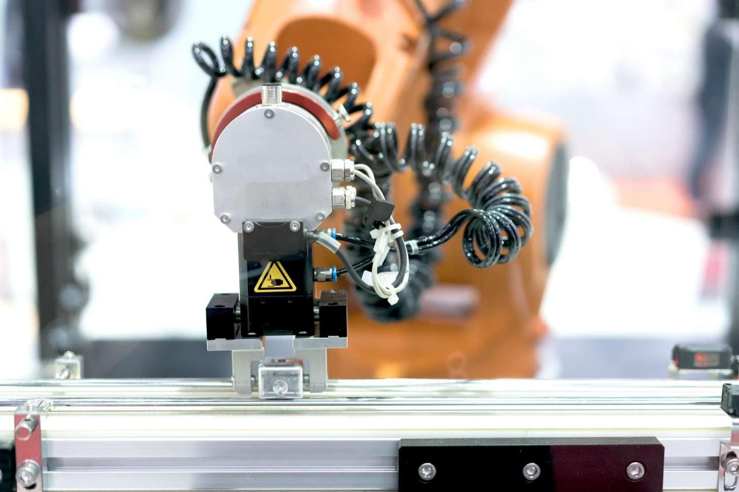 Automatic robot arm with imaging sensor in assembly line working in factory -- smart factory industry 4.0 concept