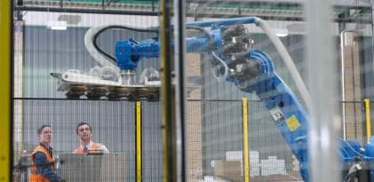 Warehouse Workers With Robot, Doncaster, UK