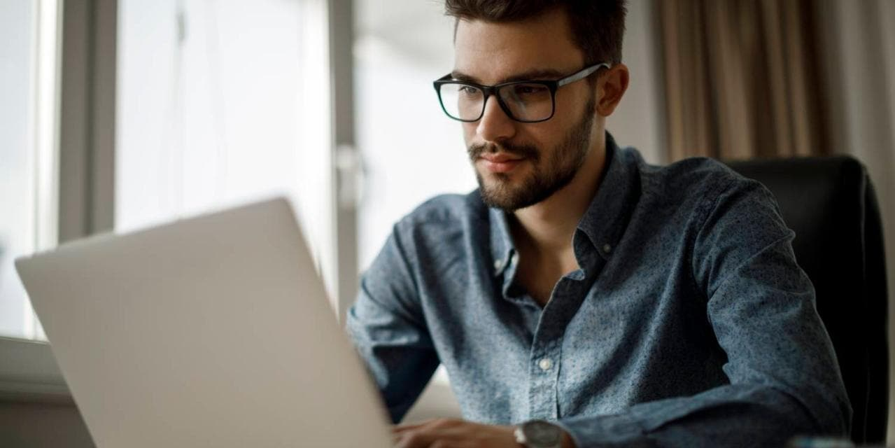 Young businessman working on laptop