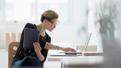 businesswoman using laptop in office, new jersey