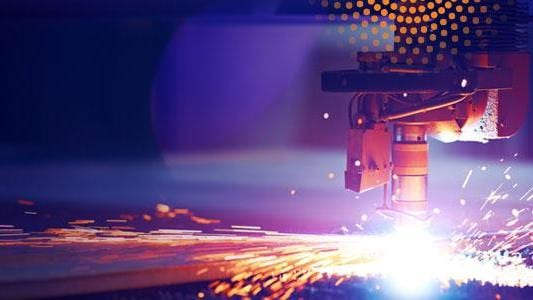 Manufacturing welder with sparks and orange radiance