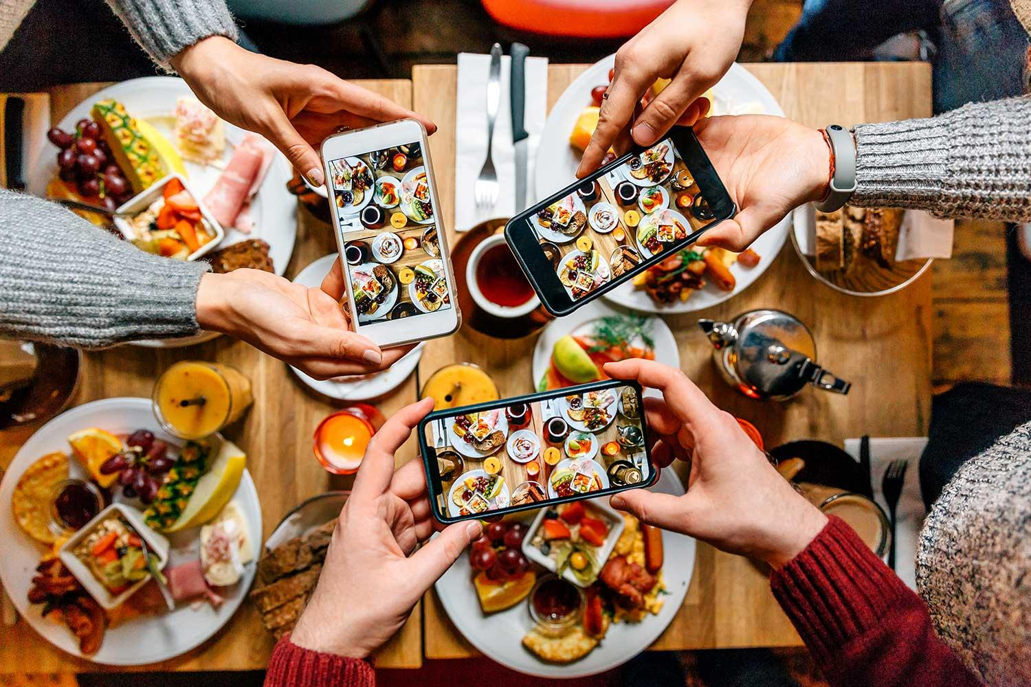 Friends taking pictures of food