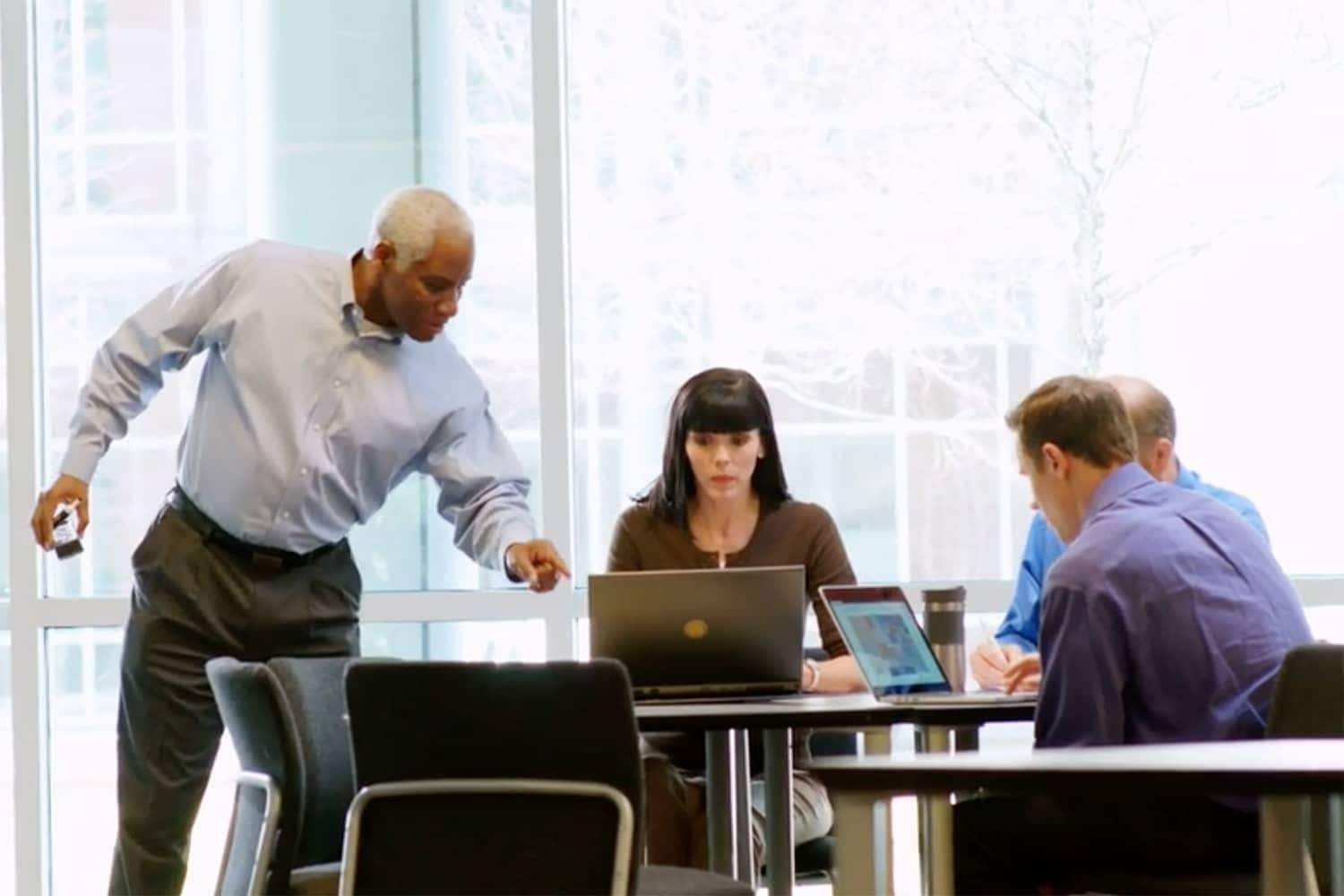 Group of coworkers collaborating in a conference room