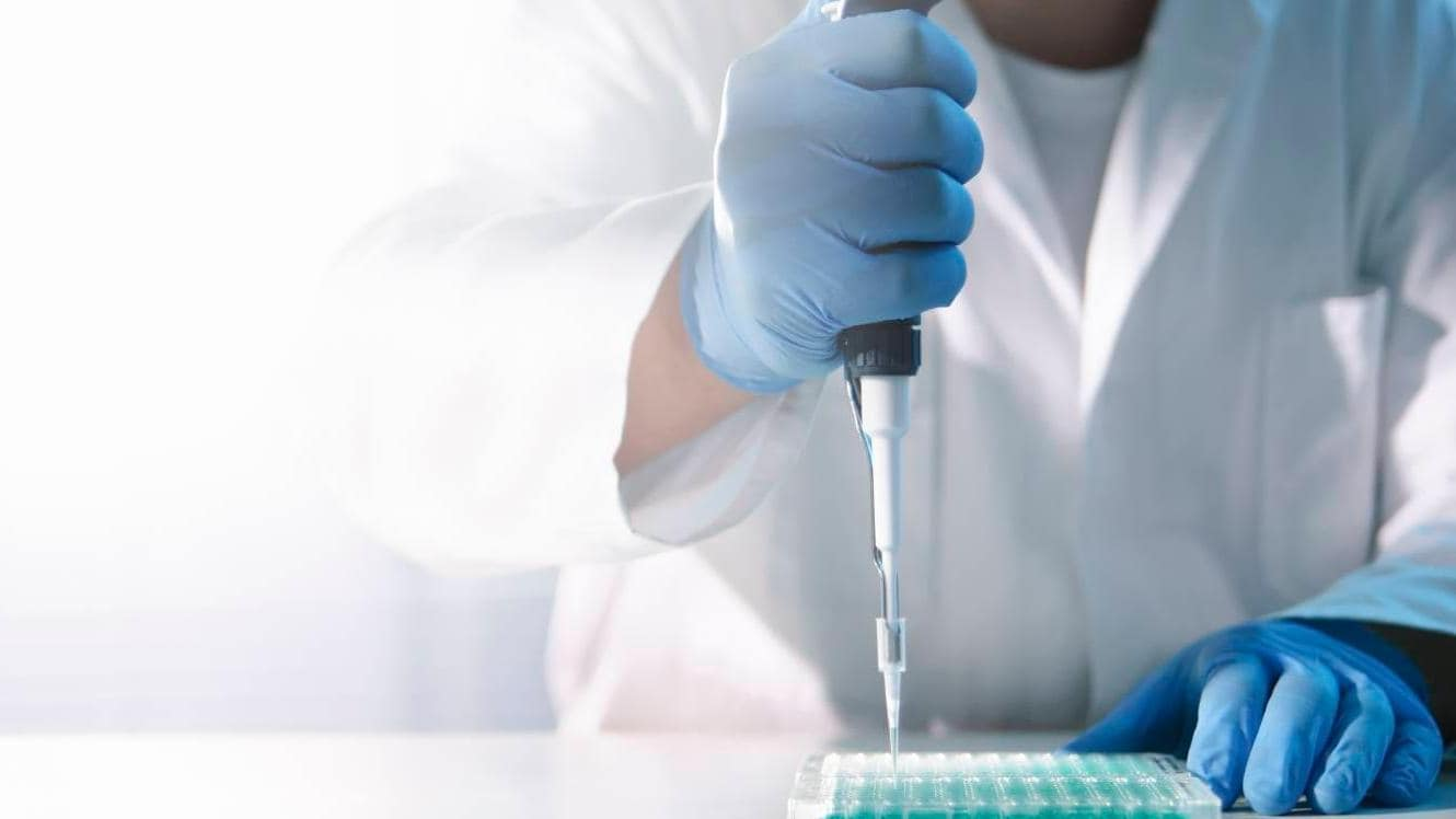 Scientist doing experiment in lab