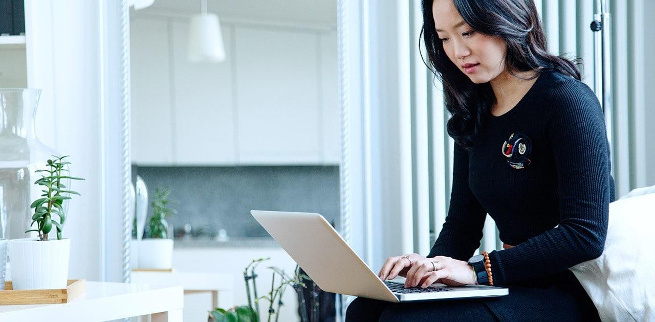 woman working at laptop image