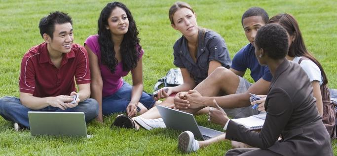 Group of students sitting outside
