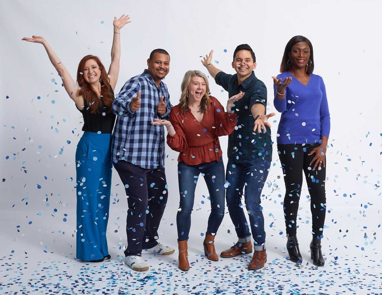 Five SAS employees celebrating with confetti shower