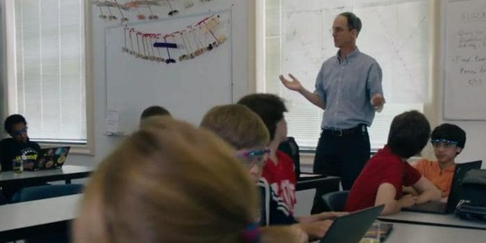 Male teacher standing in the middle of his classroom