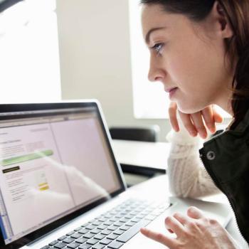 Girl looking at computer
