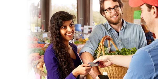young couple shopping credit card farmers market