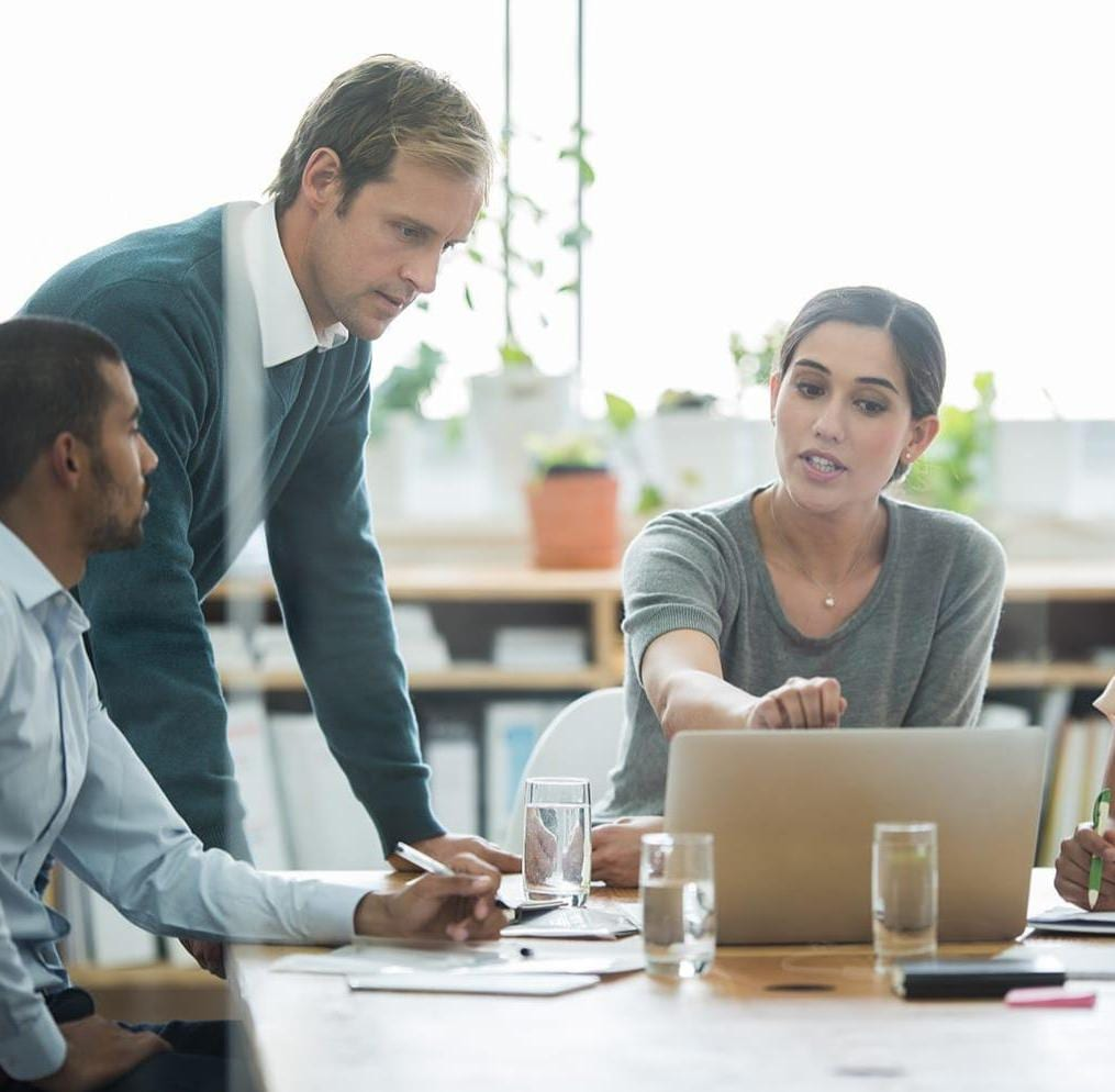 Group of coworkers having discussion in office