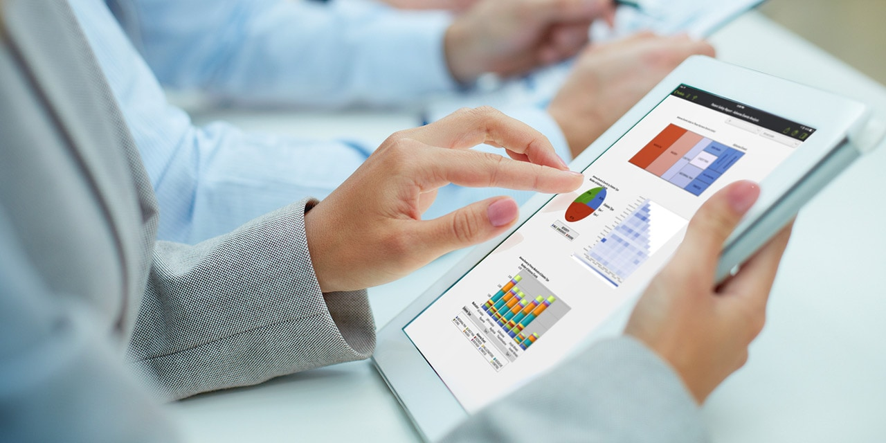 Close up of person viewing analytics on a tablet