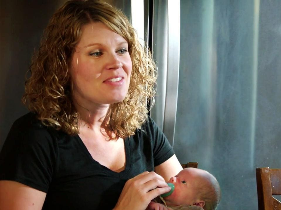 Dan Lauderdale's wife holding their baby