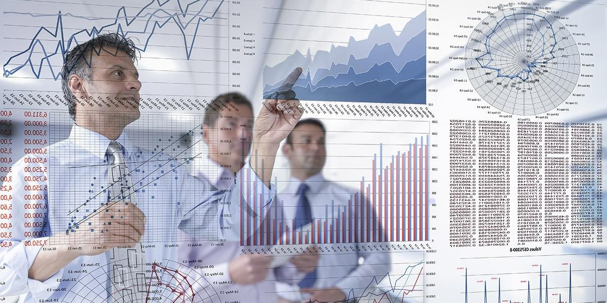 businessmen looking at charts and graphs