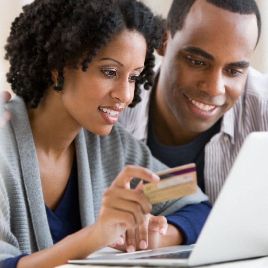 African American couple shopping online