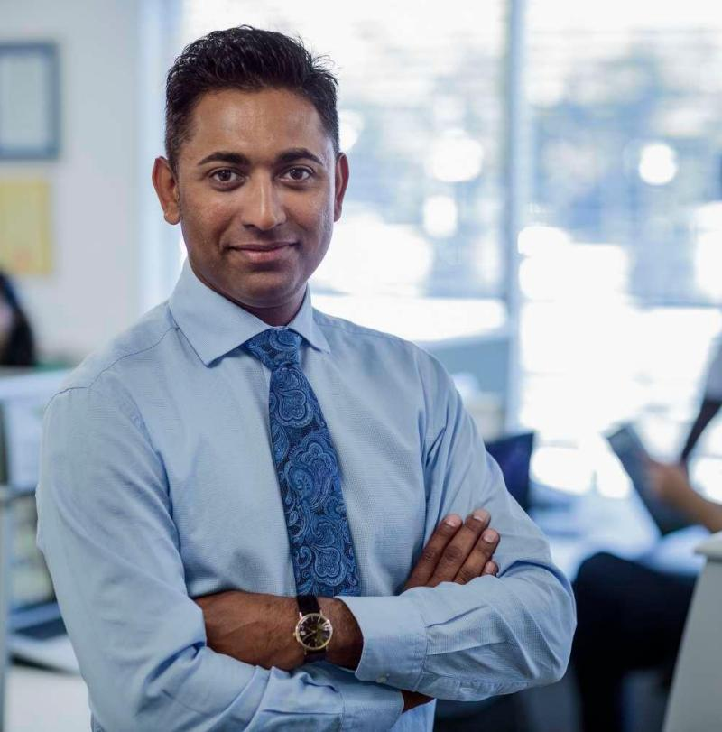 Indian man standing in office