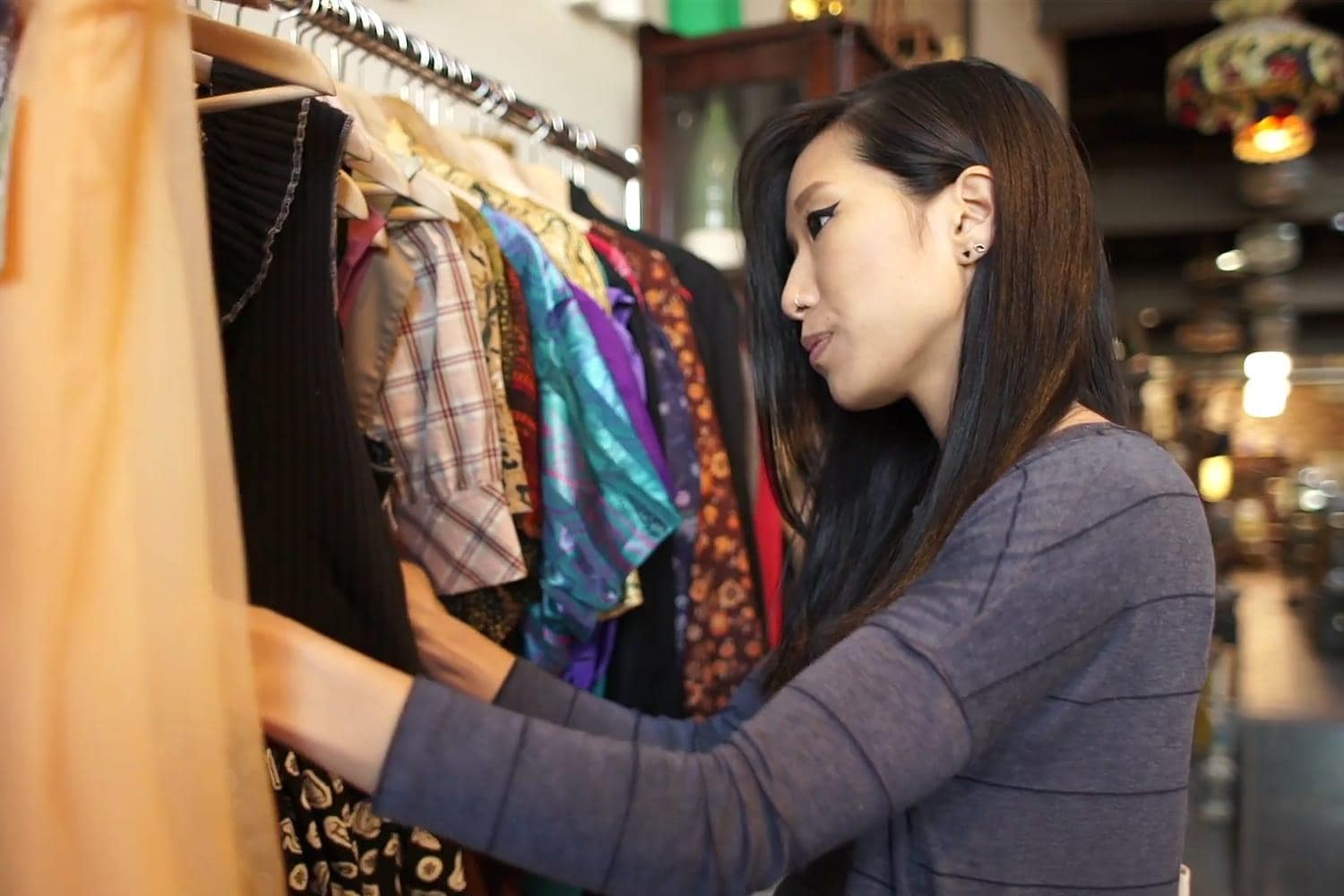 SAS Retail Analytics video still - young woman shopping at boutique shop