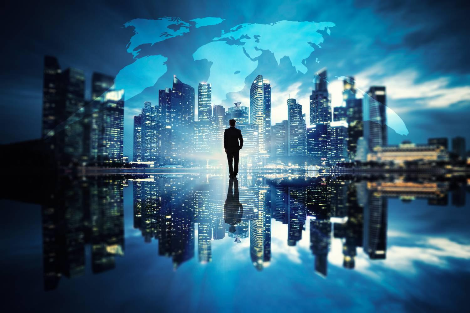Man standing facing a futuristic Singapore skyline and global world map